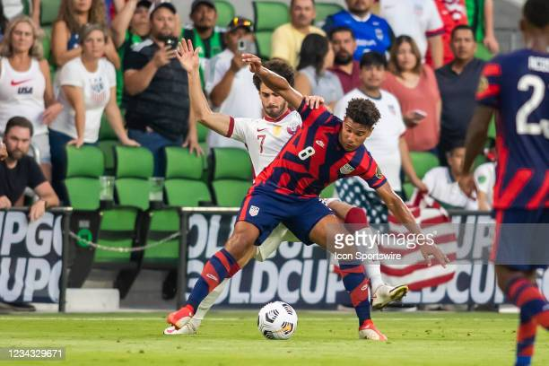 United States forward Nicholas Gioacchini attempts to shield off Qatar forward Ahmed Alaa from the ball during the Gold Cup semifinal match between...