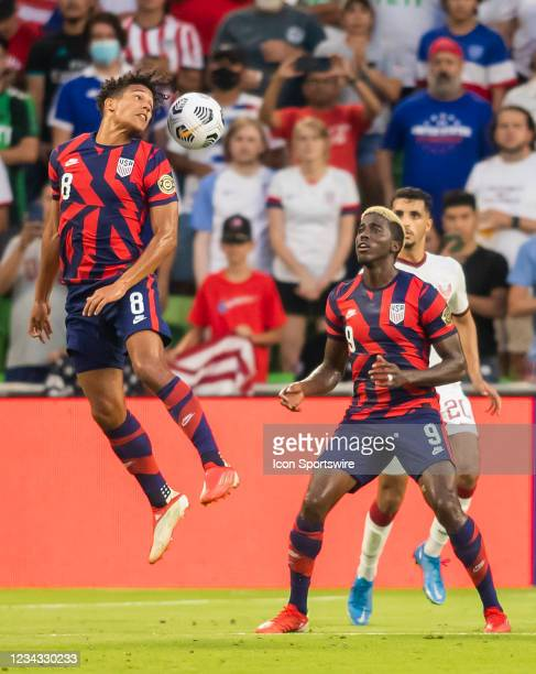 United States forward Nicholas Gioacchini heads the ball away to teammate United States forward Gyasi Zardes during the Gold Cup semifinal match...