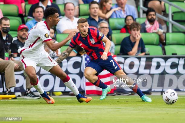United States forward Paul Arriola passes the ball infant of Qatar defender Homam Ahmed during the Gold Cup semifinal match between the United States...