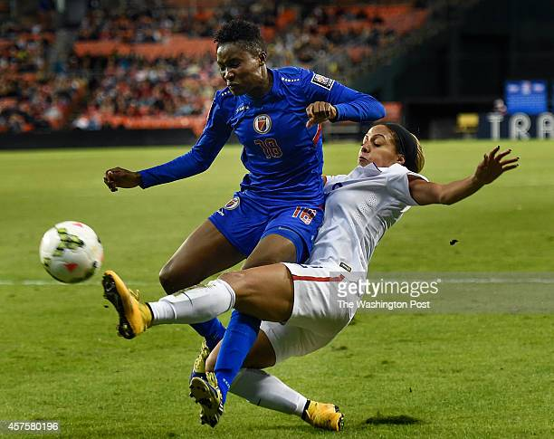 United States forward Sydney Leroux right kicks the ball away from Haiti defender Roselord Borgella during a first round game of the CONCACAF Women's...