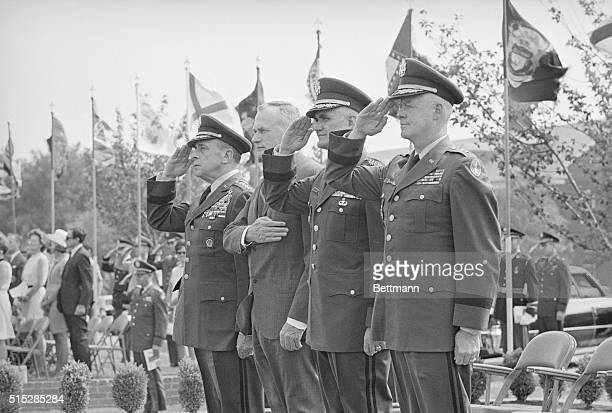 United States General Lyman L Lemnitzer salutes the colors at a retreat parade in his honor at nearby Fort Meyer Virginia Lemnitzer who will be 70...