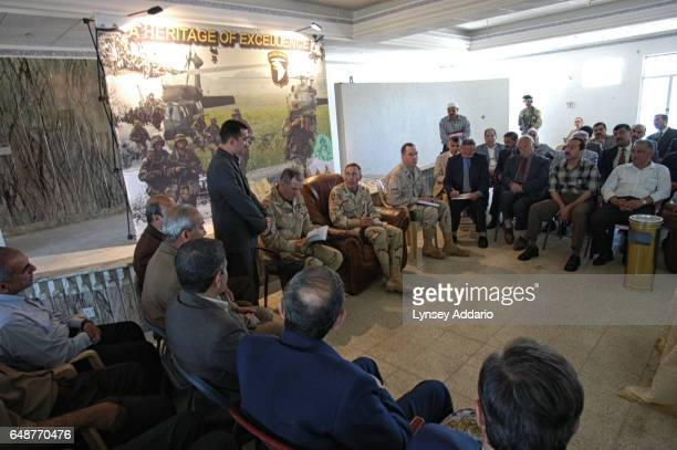 United States General Petreus commander of the 101st Airbourne Division meets with local Iraqi tribal leaders in the Division Main Headquarters in...