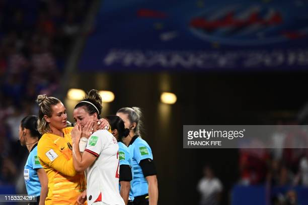 TOPSHOT United States' goalkeeper Alyssa Naeher and England's forward Beth Mead react after the France 2019 Women's World Cup semifinal football...