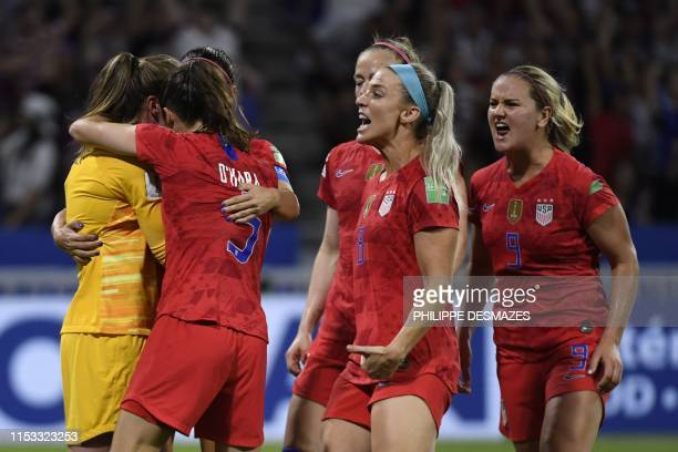 United States' goalkeeper Alyssa Naeher is congratulated by teammates after saving a penalty kick during the France 2019 Women's World Cup semifinal...
