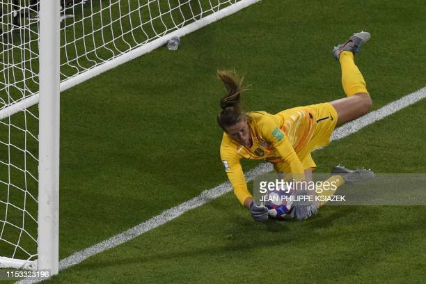 TOPSHOT United States' goalkeeper Alyssa Naeher saves a penalty kick during the France 2019 Women's World Cup semifinal football match between...