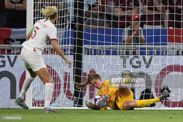 United States' goalkeeper Alyssa Naeher saves a penalty kick during the France 2019 Women's World Cup semifinal football match between England and...