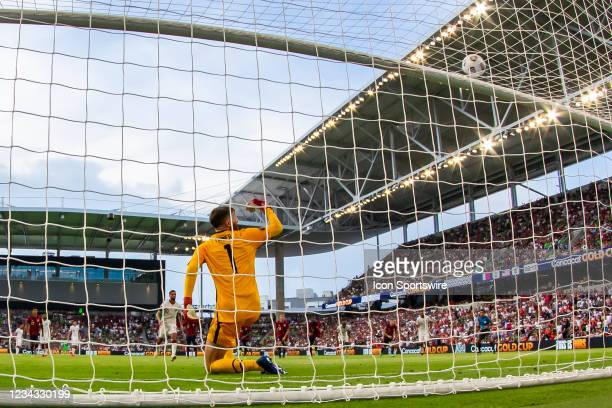 United States goalkeeper Matt Turner celebrates as the penalty kick of Qatar forward Hassan Al Haydos sails over the net during the Gold Cup...