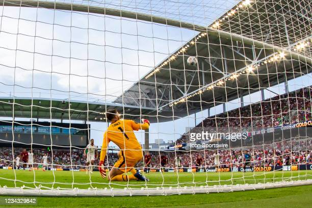 United States goalkeeper Matt Turner watches as the penalty kick of Qatar forward Hassan Al Haydos floats over the goal during the Gold Cup semifinal...