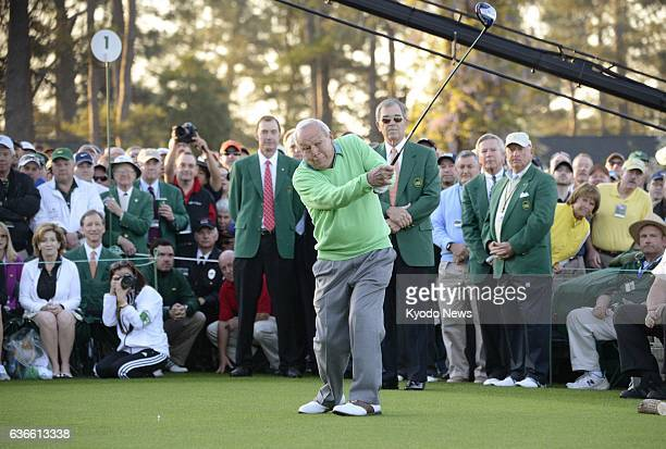 AUGUSTA United States Golf legend Arnold Palmer hits a ceremonial opening tee shot as an honorary starter to kick off the 2014 Masters Tournament at...