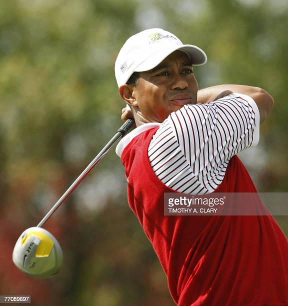 United States golfer Tiger Woods hits his drive on the 2nd hole hole during the Four-Ball Matches of The Presidents Cup 28 September 2007 at The...