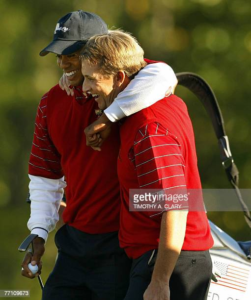 United States golfers Tiger Woods and David Toms hug after winning their match on the 15th hole during the Four-Ball Matches of The Presidents Cup 29...