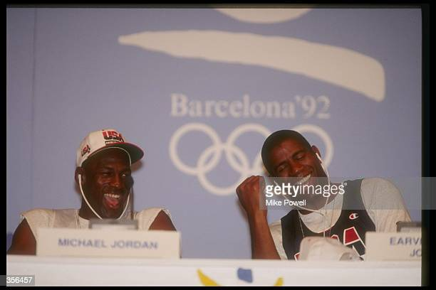 United States guards Michael Jordan and Earvin 'Magic' Johnson laugh at a press conference during the Olympic Games in Barcelona Spain Mandatory...