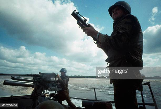 United States gunners on the deck of a swift boat leaving the Ca Mao River estuary Vietnam 1969 | Location Ca Mao River Vietnam
