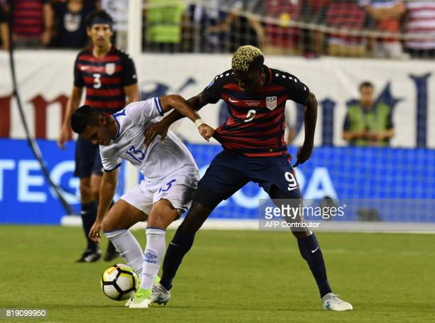 United States' Gyasi Zardes battles El Salvador's Alexander Larin during their CONCACAF tournament quarterfinal match at Lincoln Financial Field on...