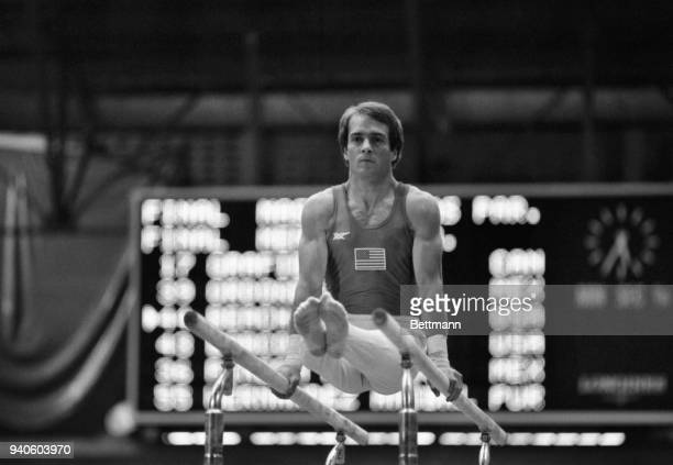 United States gymnast Thomas Beach, Torrance, CA, swings through his parallel bar program during competition at the Pan American Games. Although the...