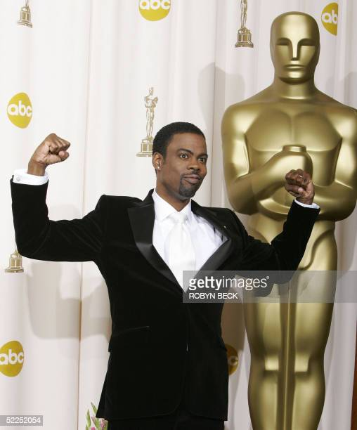 Host Chris Rock poses after the end of the Oscars show at the Kodak Theater in Hollywood California 27 February during the 77th Academy Awards AFP...
