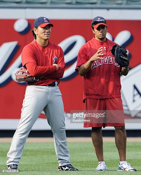 BALTIMORE United States In this photo taken Aug 4 Hideki Matsui and his interpreter Rogelio Kahlon talk on the field at Oriole Park Baltimore...