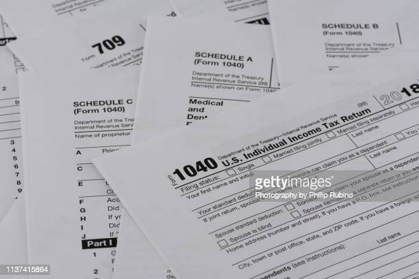 united states internal revenue tax return forms - irs stock pictures, royalty-free photos & images