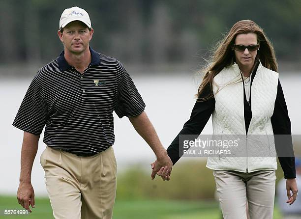 International player Retief Goosen and his wife Tracy walk handinhand following afternoon Fourball matches against the USA at the 2005 Presidents Cup...