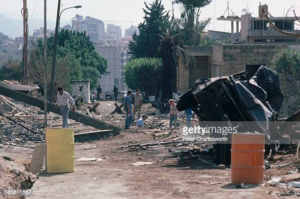 United States investigators check the bomb crater at the US Embassy Annex building in East Beirut after it was badly damaged by a suicide truck bomb...