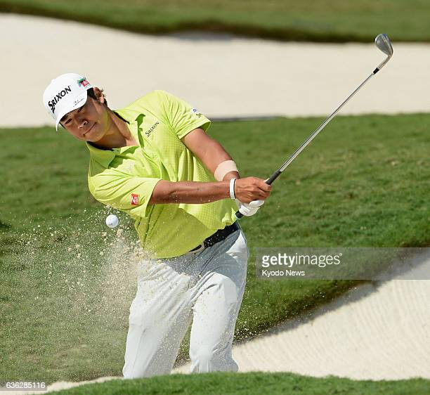 DORAL United States Japanese golfer Hideki Matsuyama makes a bunker shot on the No 18 hole during his practice round for the WGC Cadillac...