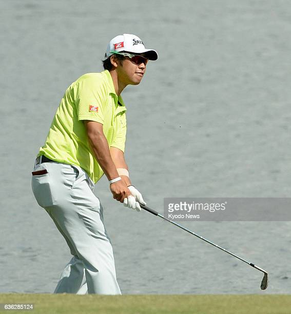 DORAL United States Japanese golfer Hideki Matsuyama makes a lefthanded shot on the No 18 hole during his practice round for the WGC Cadillac...