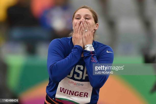 United States' Kara Winger celebrates after winning the gold medal in the Athletics Women's Javelin Throw Final during the Lima 2019 Pan-American...