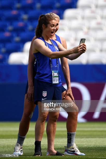 United States' Kelley O Hara takes a selfie with a teammate during a training for the France 2019 Women's World Cup at the Groupama stadium in Lyon...
