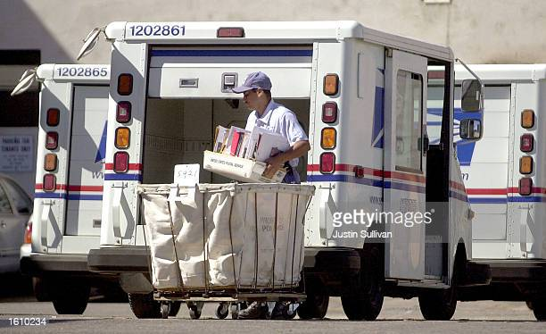 United States mail carrier in Gary Condit''s congressional district loads his truck August 23, 2001 in Modesto, California. Condit mailed more than...