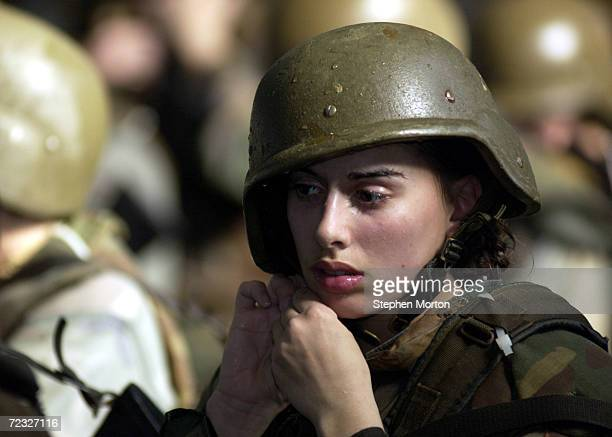 United States Marine Corps female recruit Stephanie Palladino adjusts her Kevlar helmet January 15 2003 before reentering the Combat Pool for another...