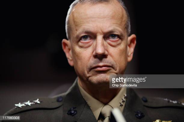 United States Marine Corps Lieutenant General John Allen prepares to testify before the Senate Armed Services Committee on Capitol Hill June 28 2011...