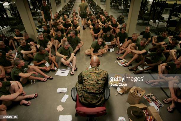 United States Marine Corps recruit senior drill instructor Staff Sergeant Hugo Cherena of Waterbury Connecticut distributes mail to his recruits...