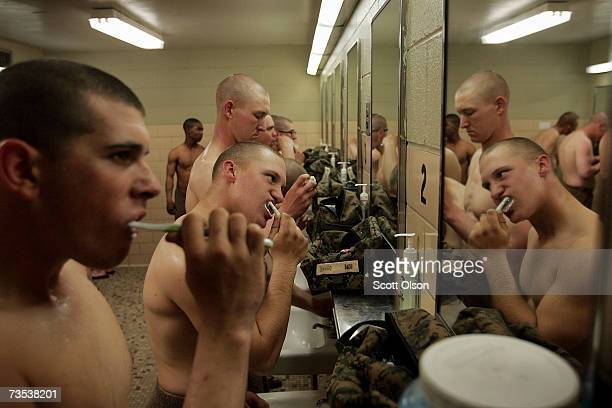 United States Marine Corps recruits brush their teeth near the end of their training day during boot camp March 7 2007 at Parris Island South...