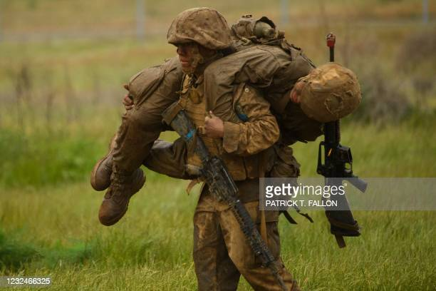United States Marine Corps recruits from Lima Company, the first gender integrated training class in San Diego, carry one another during an obstacle...