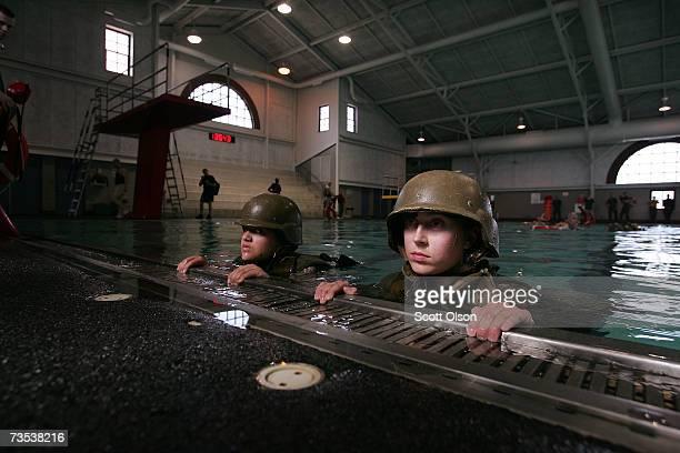 United States Marine Corps recruits Vanessa Skillings of Palmdale California and Felicia Gero of Plattsburgh New York participate in swim...