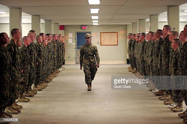 United States Marine Corps senior drill instructor Staff Sergeant Hugo Cherena of Waterbury Connecticut addresses his recruits during boot camp March...
