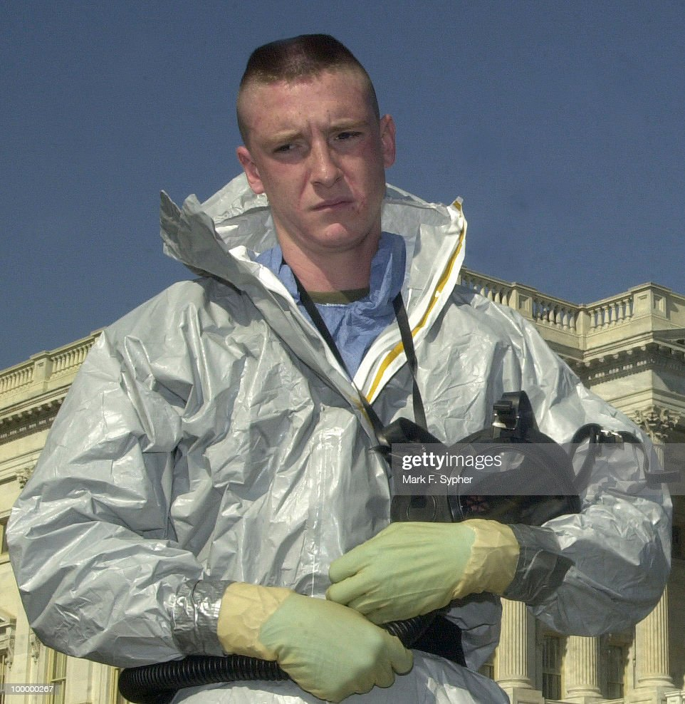 A United States Marine, from the Chemical Biological Response Force, stands at the House Triangle on Tuesday, after removing his mask resporator and headgear.