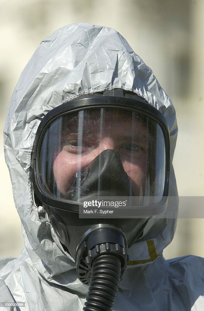 A United States Marine from the Chemical Biological Response Force, donning his mask and protective suite at the House Triangle.