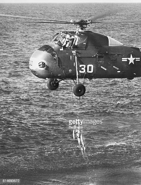 A United States Marine helicopter lifts astronaut Virgil Grissom from the Atlantic Ocean after his Liberty Bell 7 capsule lands after a suborbital...