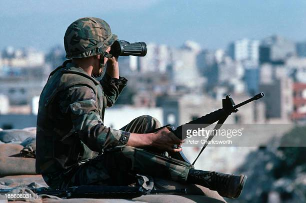 United States Marine mans a fortified position inside Beirut's international airport. The American military was in Beirut as part of a Multinational...