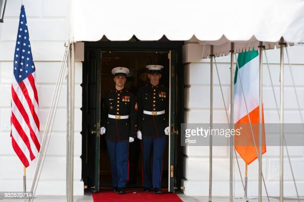 United States Marines exit the East Wing of the White House as President Donald Trump and first lady Melania Trump prepare to greet Prime Minister...