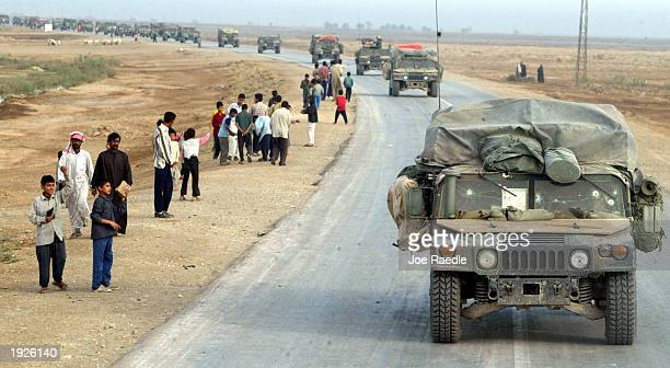 United States Marines from Task Force Tarawa are greeted by Iraqi locals along the roadside April 12 2003 near Al Kut Iraq The Marines are sweeping...