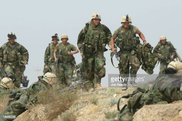 United States Marines from Task Force Tarawa battle with Iraqi troops March 24, 2003 in the southern Iraqi city of Nasiriyah. The Marines have had...