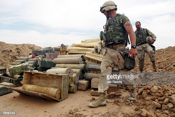 United States Marines from Task Force Tarawa look at a cache of weapons found near an Iraqi military facility April 12 2003 near Al Kut Iraq The...