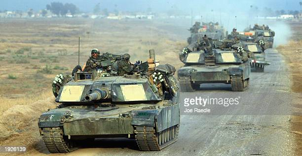 United States Marines from Task Force Tarawa travel along a road April 12 2003 near Al Kut Iraq The Marines are sweeping through the country...