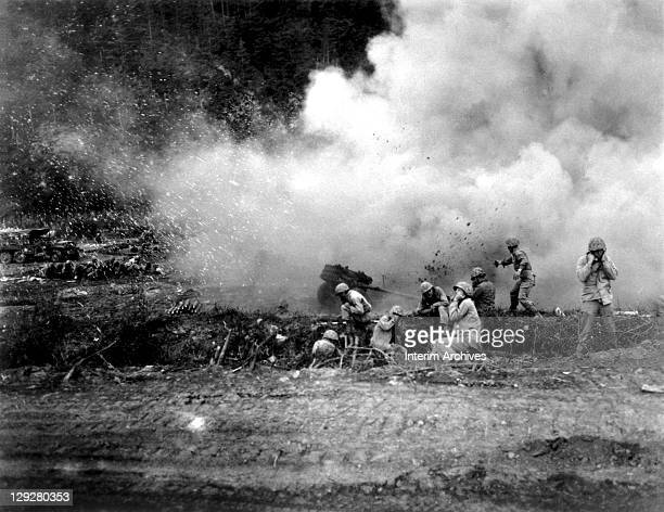 United States Marines launch a 4.5 inch rocket barrage against the Chinese Communists during fighting in the Korean War, 1951.