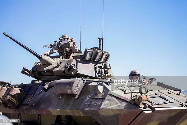 United States Marines military tank with soldiers on board
