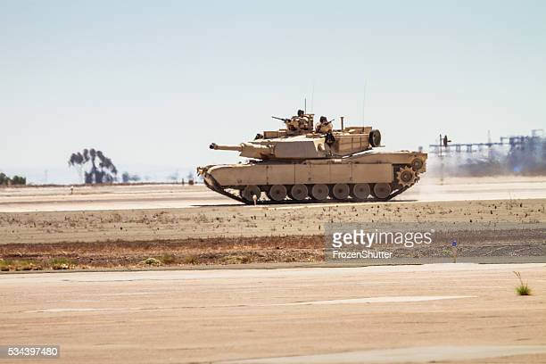 united states marines military tank with soldiers on board - armored tank stock photos and pictures