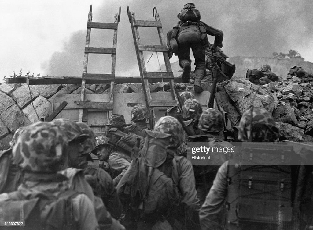 United States' Marines use scaling ladders to climb the shore cliffs at Inchon, Korea during an amphibious invasion during the Korean War.