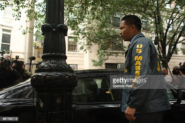 United States marshals exit the building where former financier Bernard Madoff and his wife Ruth owned an apartment on July 2 2009 in New York New...